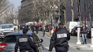 Police outside the International Monetary Fund (IMF) offices where an envelope exploded in Paris on Thursday.
