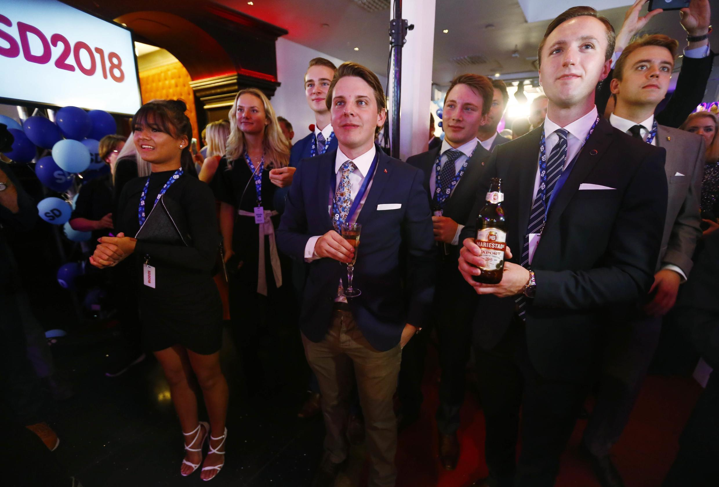 Swedish Social Democrats listen to the results of the election in Stockholm