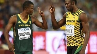 Usain Bolt with Anaso Jobodwana before the men's 200 metres final