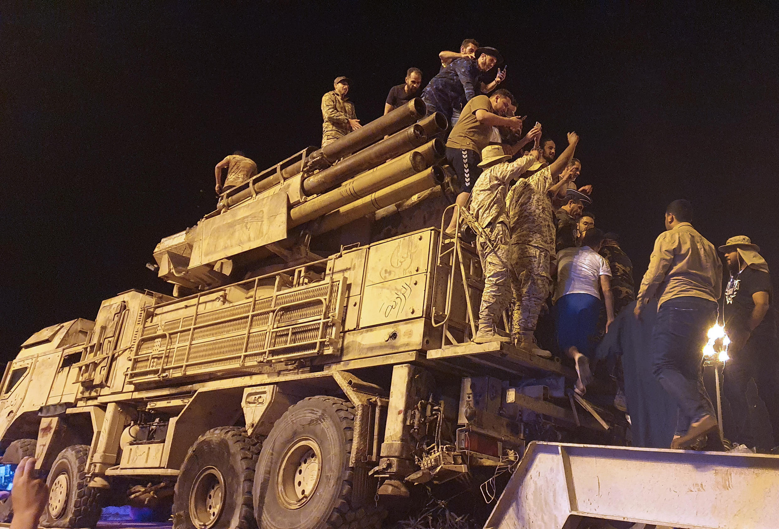 Forces loyal to Libya's UN-recognized Government of National Accord parade a Pantsir air defense system truck in the capital Tripoli on May 20, 2020 after its capture at a nearby airbase from strongman Khalifa Haftar