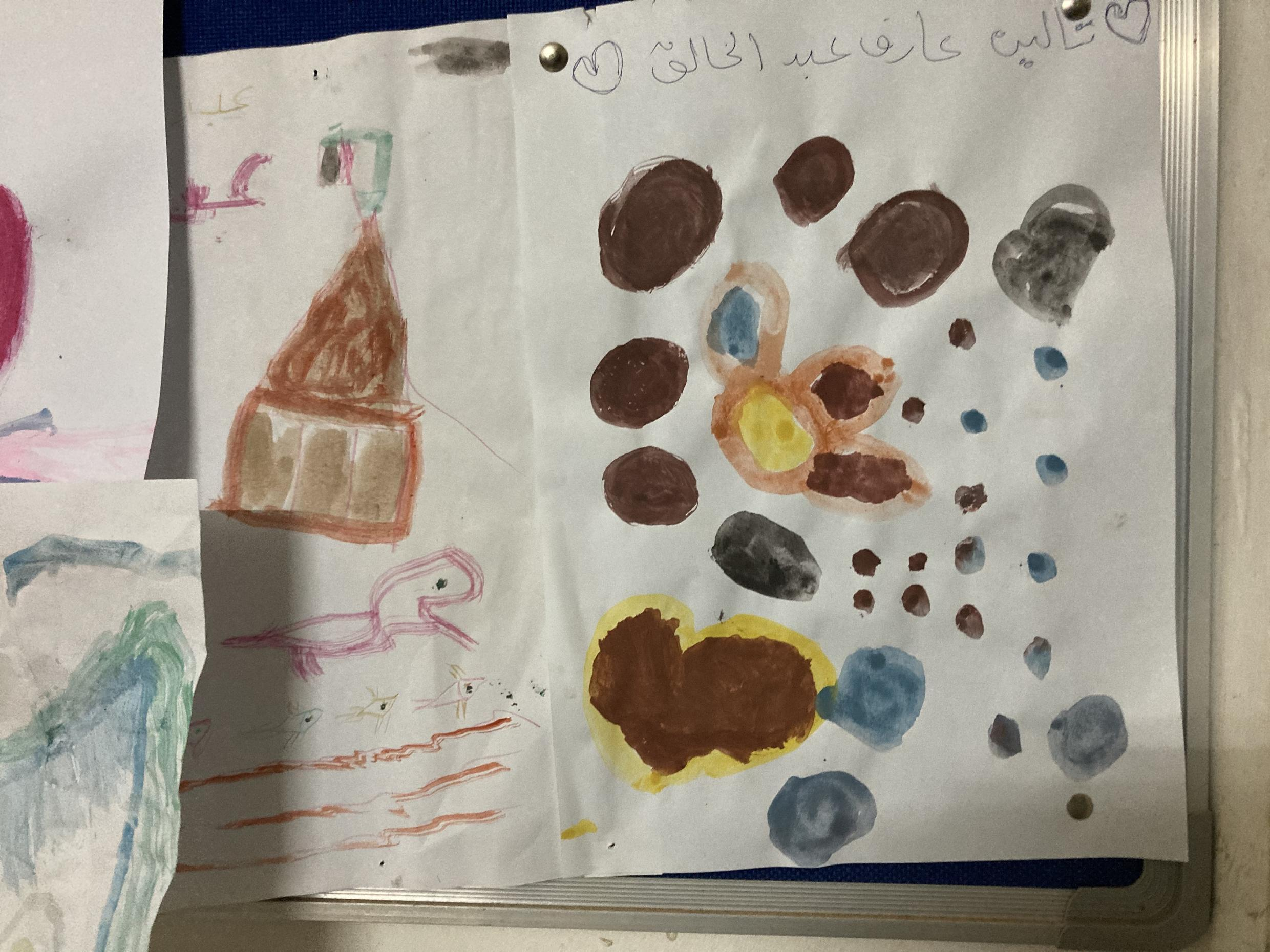 Artwork done by children as part of their therapy at SEEMA after witnessing or experiencing violence.