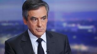 François Fillon is seen prior to a prime-time news broadcast in the studios of TF1 in Boulogne-Billancourt, near Paris.