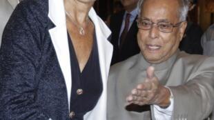 A ministra francesa das Finanças, Christine Lagarde e o seu colega de pasta, o ministro indiano Pranab Mukerjee.