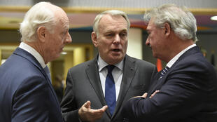 UN Secretary-General's Special Envoy for Syria, Staffan de Mistura (left) talks with French Foreign Affairs minister Jean-Marc Ayrault (centre) and Luxembourg Foreign minister Jean Asselborn (right) during a conference on Syria in Brussels.