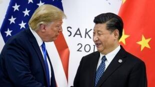 Donald Trump et Xi Jinping lors de leur sommet bilatéral en marge du G20, le 29 juin 2019 à Osaka