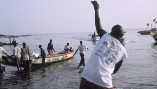 Fishermen on their pirogue boat, Dakar, Senegal.
