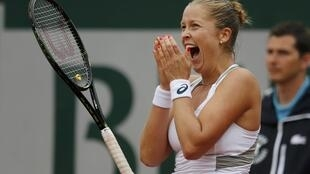 Shelby Rogers reacts after winning her match against Irina Camelia-Begu  in round four of the French Open on Sunday.