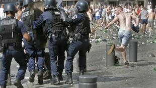 England vs. Russia in Group B at the Stade Velodrome, Marseille, France, on June 11, 2016. Police chase a supporter at the port of Marseille.