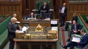 A video grab from footage broadcast by the UK Parliament's Parliamentary Recording Unit (PRU) shows Britain's Prime Minister Boris Johnson giving a statement in the House of Commons in London on the easing of coronavirus restrictions.