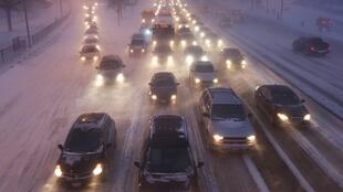 Rush hour traffic crawls as blowing snow batters Lake Shore Drive in Chicago 1 February 2011.