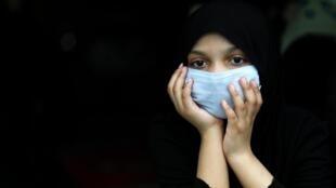 Une femme musulmane chiite lors de l'Achoura, à New Delhi, Inde, le 30 août 2020.