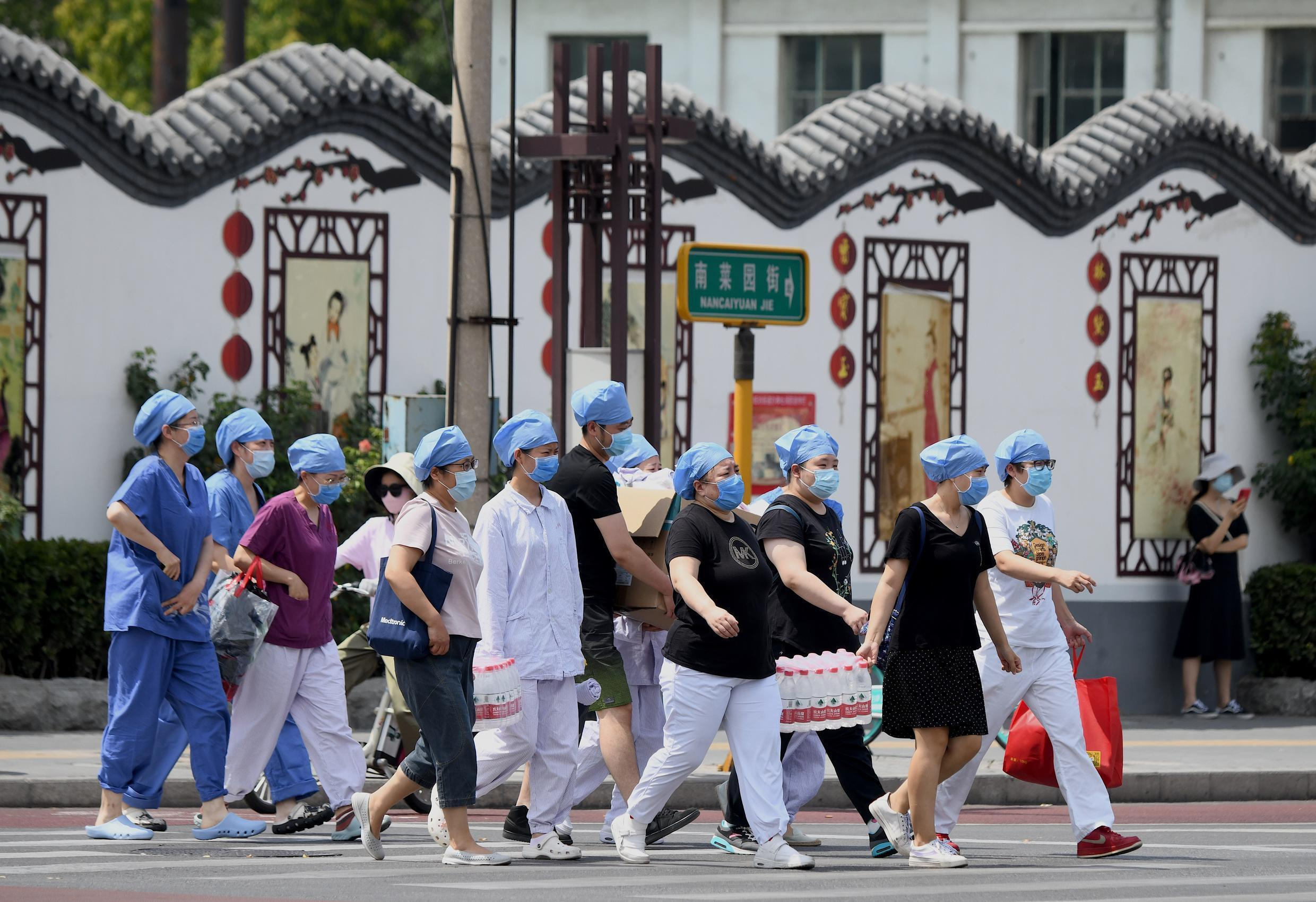 Authorities in the Chinese capital Beijing are rushing to contain a new outbreak of the coronavirus linked to a wholesale food market