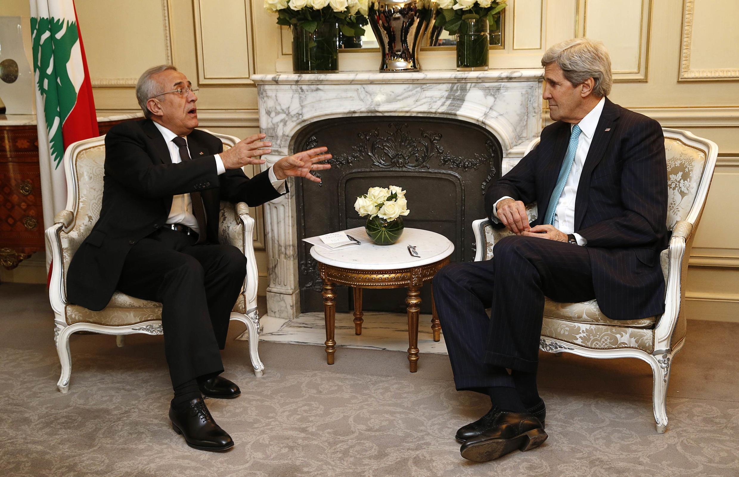 Lebanese President Michel Sleiman (L) and US Secretary of State John Kerry after the International Support Group for Lebanon meeting at the Elysee Palace