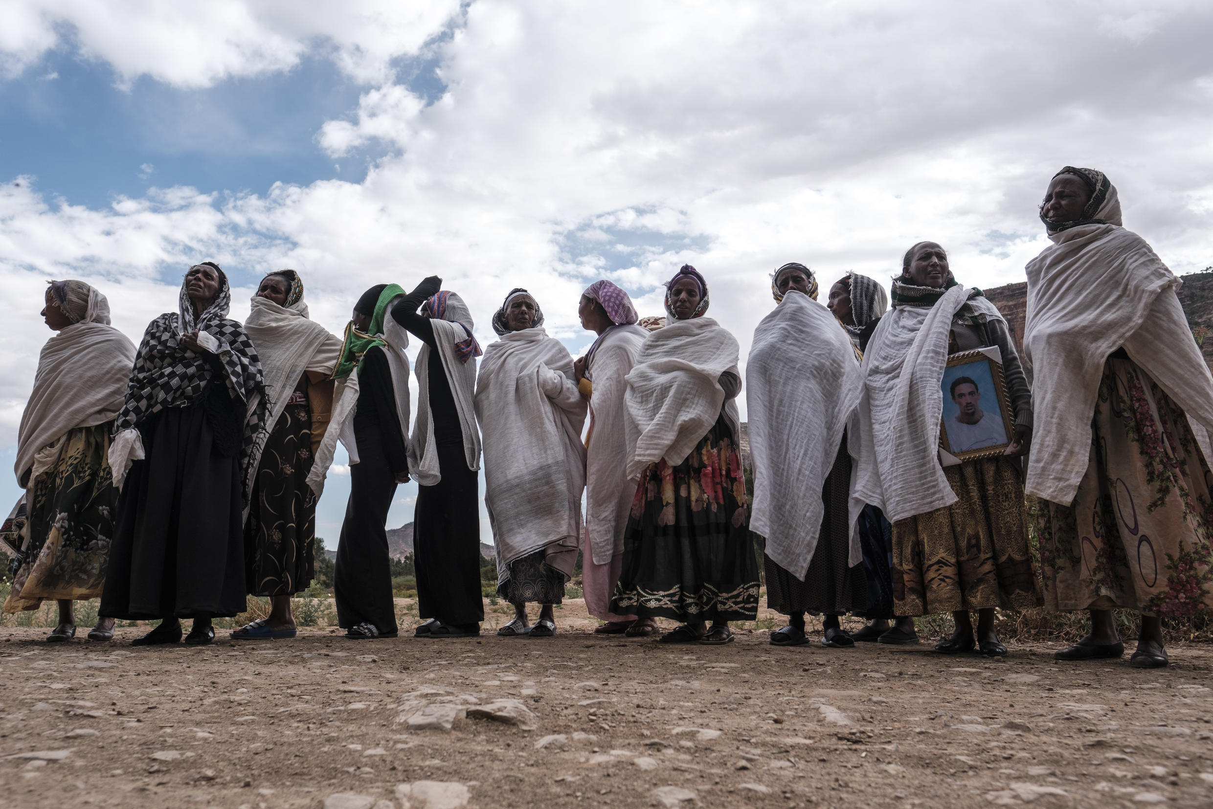 Women gather to mourn the victims of a massacre allegedly perpetrated by Eritrean soldiers in the village of Dengolat, north of Mekele, the capital of Tigray, on February 26, 2021