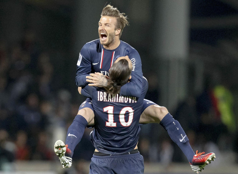 Vainqueur de l'Olympique Lyonnais (1-0) le 12 mai, le PSG est assuré de finir en tête de la Ligue 1. David Beckham et Zlatan Ibrahimovi sautent de joie.