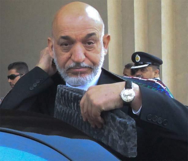 Karzai arrives at a military base in Rawalpindi