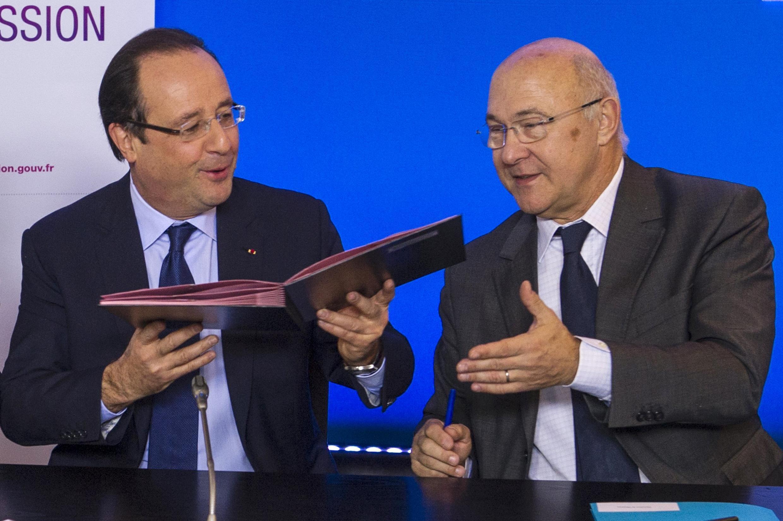 Президент Франции Франсуа Олланд и министр труда Мишель Сапен