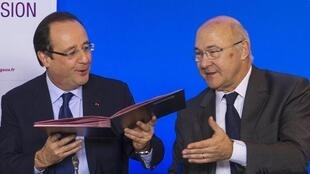 French president François Hollande and Labour minister Michel Sapin