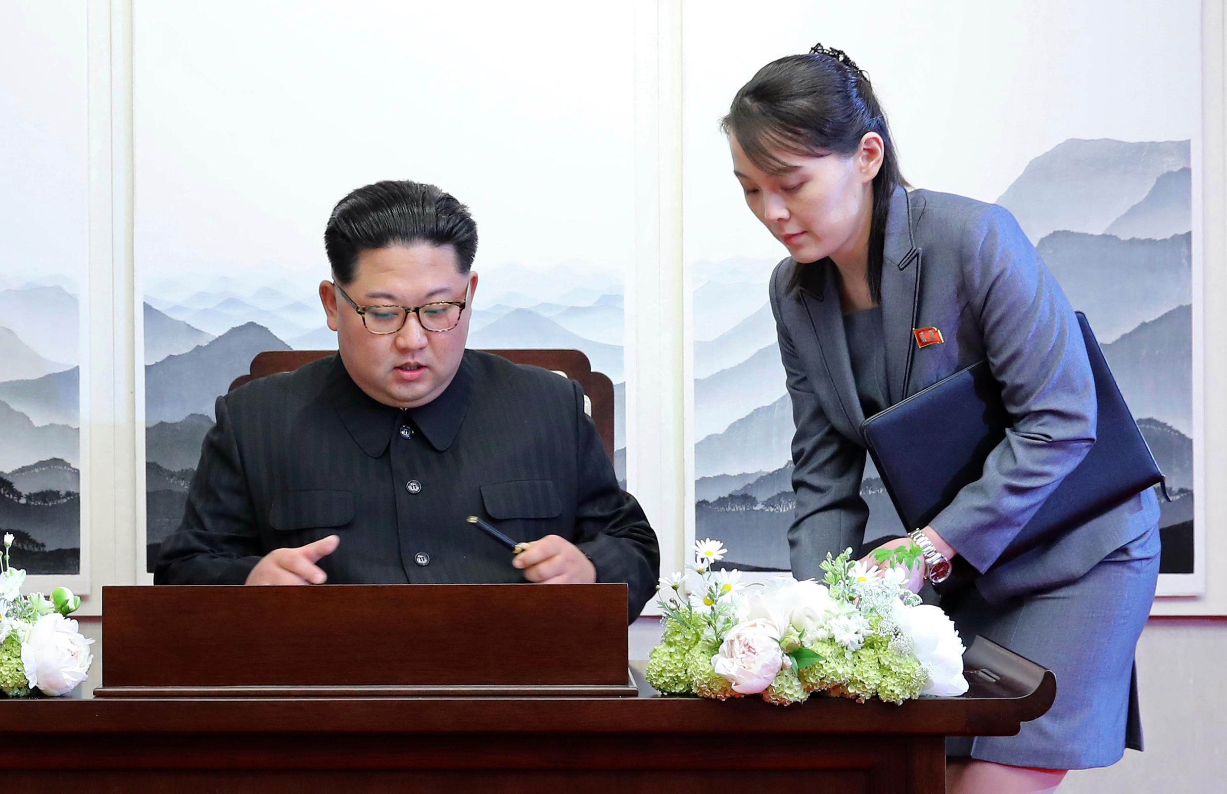 In this April 27, 2018, file photo, North Korean leader Kim Jong Un signs a guestbook next to his sister Kim Yo Jong, right, inside the Peace House at the border village of Panmunjom in Demilitarized Zone. With North Korea saying nothing so far about outside media reports that leader Kim Jong Un may be unwell, there's renewed worry about who's next in line to run a nuclear-armed country that's been ruled by the same family for seven decades.