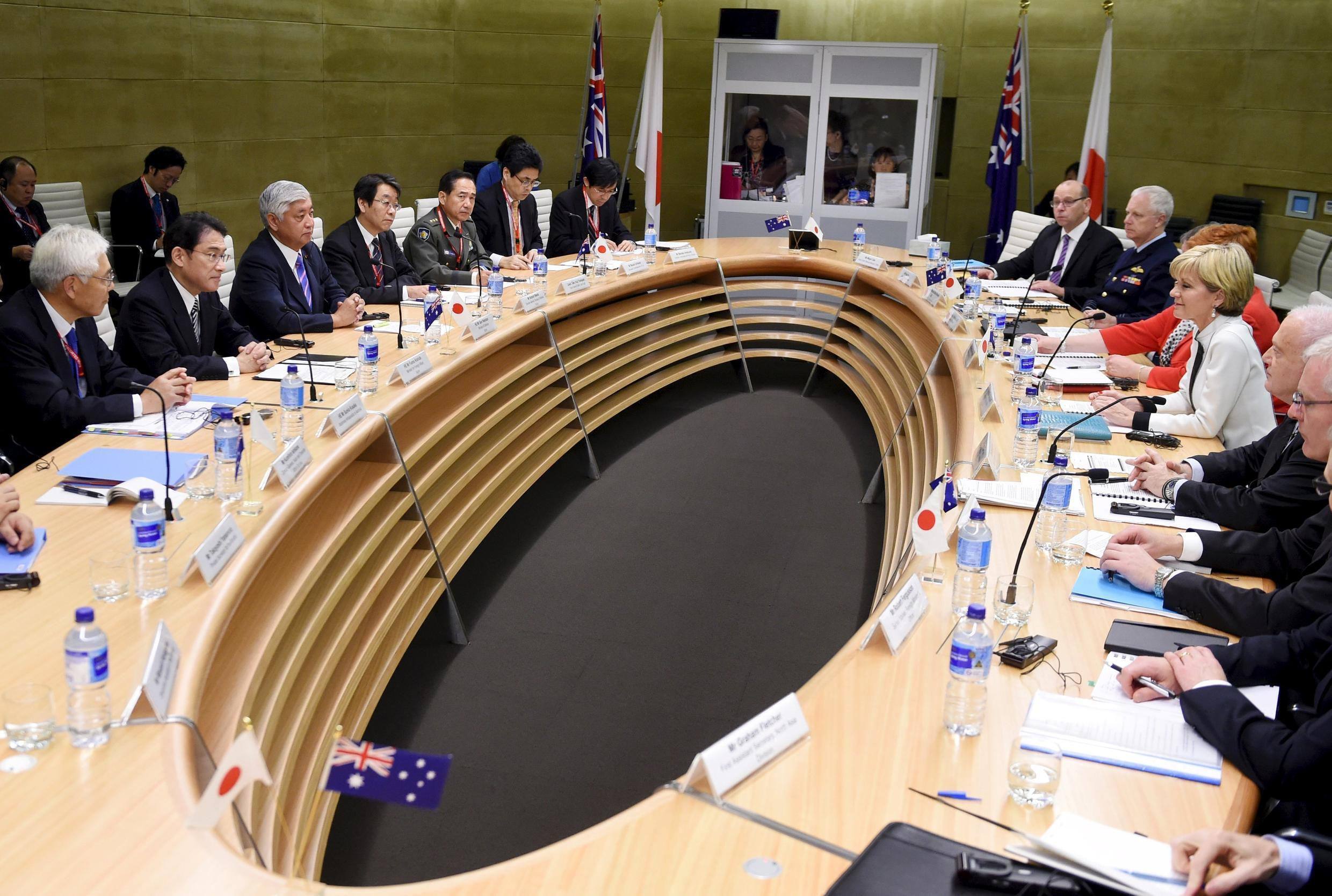 Australian Foreign Minister Julie Bishop (R) sits with Australia's Defence Minister Marise Payne (2nd R) opposite Japan's Defense Minister Gen Nakatani (3rd L) and Japan's Foreign Affairs Minister Fumio Kishida (2nd L) as they hold bilateral talks in Sydne