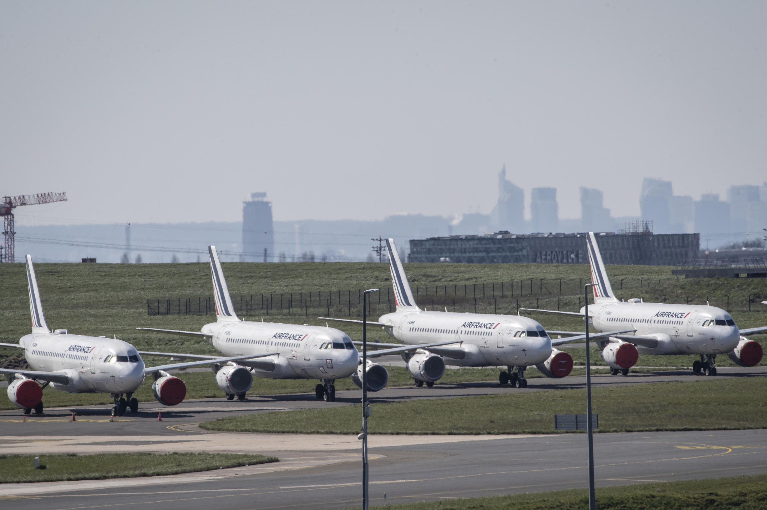 Grounded Air France airplanes (pictured March 2020) sit at the Roissy-Charles de Gaulle airport in Roissy-en-France, north of Paris, after the coronavirus pandemic forced the grounding of planes around the world as borders and airports were closed