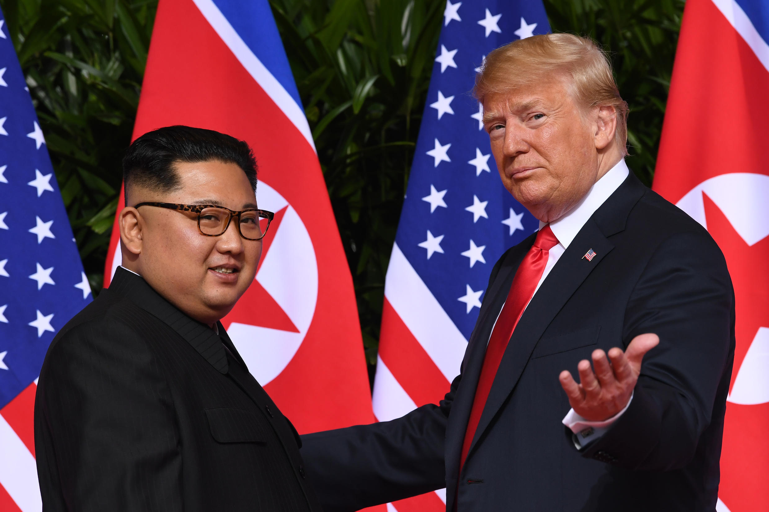 """US President Donald Trump (R) meets with North Korea's leader Kim Jong Un (L) at the start of their summit in Singapore on June 12, 2018 -- two years on, Pyongyang says any hopes for better ties have turned to feelings of """"despair"""""""