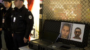 Police at Paris's Roissy Charles-de-Gaulle airport with the photos of Paris attackers Salah Abdeslam and Mohamed Abrini