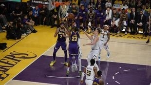 LeBron James (number 23) reached his points milestone during his LA Lakers match against the Denver Nuggets.