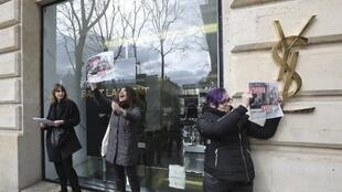 Protestors in front of a Yves Saint-Laurent shop in Paris on March 7, 2017.