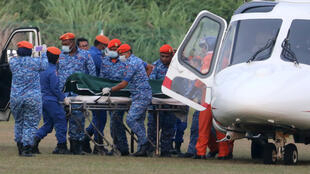 A body believed to be 15-year-old Irish girl Nora Anne Quoirin who went missing is brought out of a helicopter in Seremban, Malaysia, August 13, 2019.