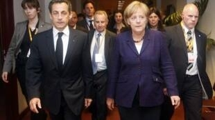 France's President Sarkozy and Germany's Chancellor Merkel during a eurozone summit in Brussels