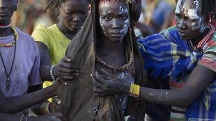 In Kenya, a woman is taken to rest after having been circumsised.