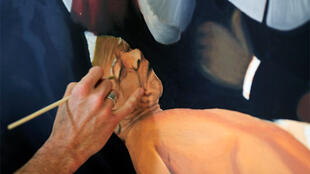Artist Yuill Damaso finishes his oil canvas The Anatomy Lesson of Dr Tulp inside a shopping mall in Johannesburg