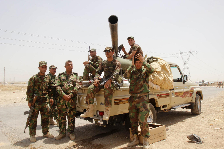 Des membres des forces de sécurité kurdes à la sortie de Kirkouk, mercredi 11 juin. Les Peshmergas ont pris le contrôle total de la ville ce jeudi 12 juin.
