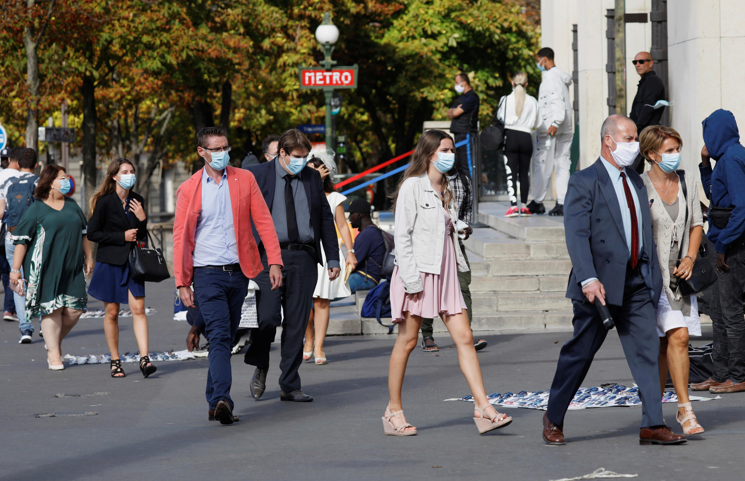 People wearing protective masks leave a Paris metro station as France reinforces mask-wearing as part of efforts to curb a resurgence of Covid-19 across the country, 28 August 2020.