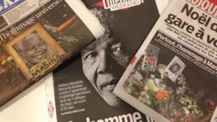 Jornais franceses destacam homenagens mundiais a Nelson Mandela.