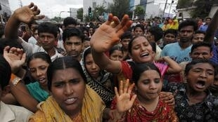 Garment workers shout during a protest in Dhaka