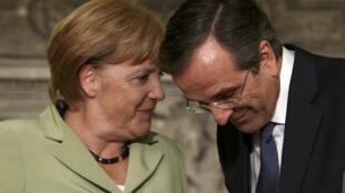 La chancelière allemande Angela Merkel s'est entretenue avec le Premier ministre grec, Antonis Samaras, à Athènes, le 9 octobre.