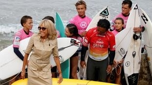 French First Lady Brigitte Macron, shown here with a group of surfers on the sidelines of the G7 meeting in Biarritz, where she read the first messages of support after being the target of insults by Brazilian President Jair Bolsonaro.