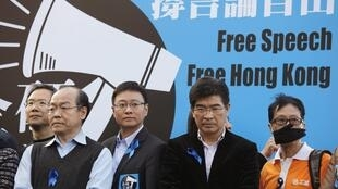 capdevielle Protesters, including pro-democracy lawmakers, stand in front of a banner during a demonstration demanding for freedom of speech and press freedom in Hong Kong February 23, 2014.