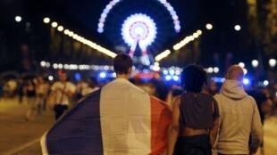 France fans celebrate on the Champs Elysées