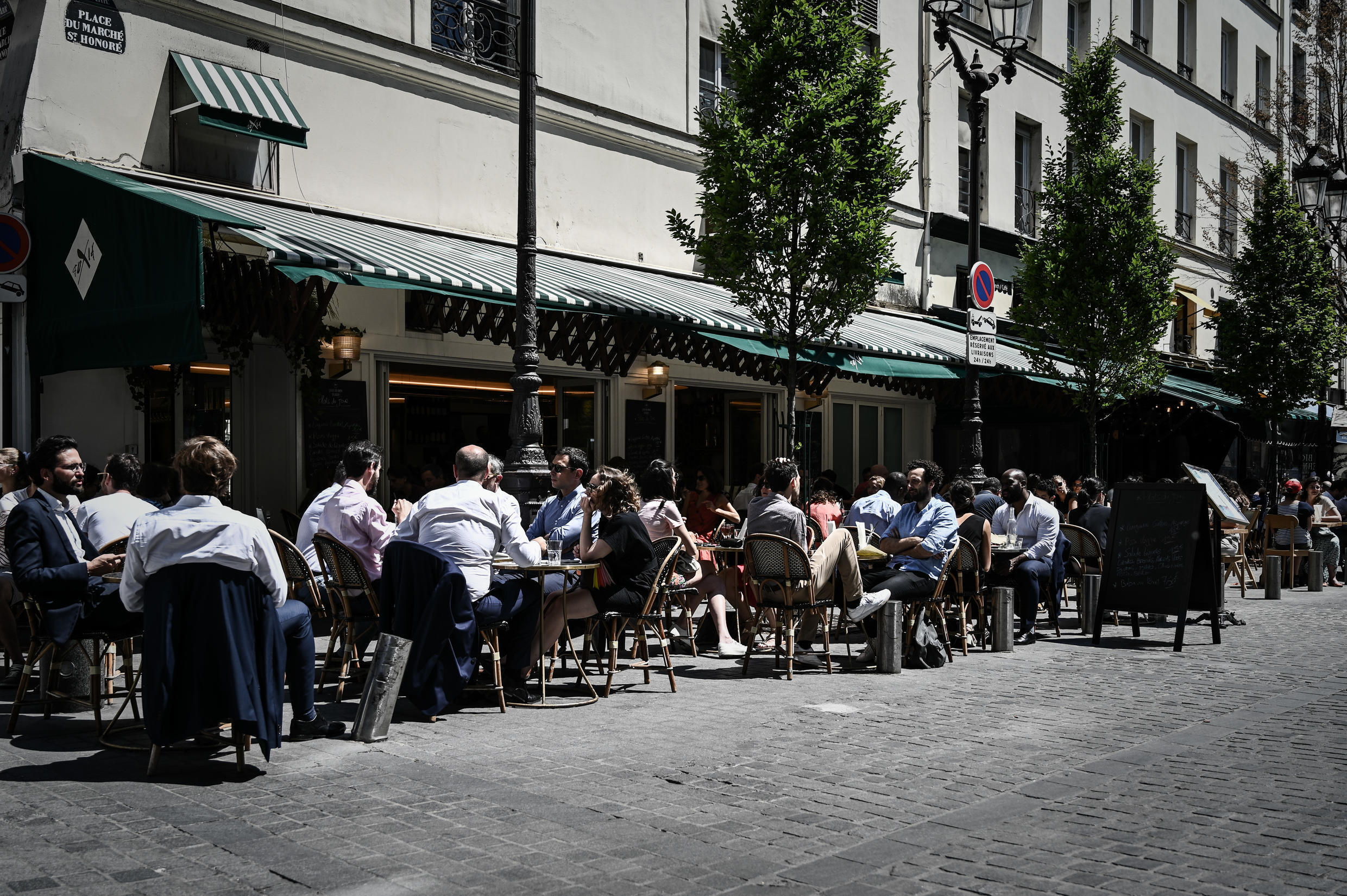 Customers sit at the terrasse of a restaurant in Paris on June 2, 2020, as cafes and restaurants reopen in France, while the country eases lockdown measures taken to curb the spread of Covid-19.