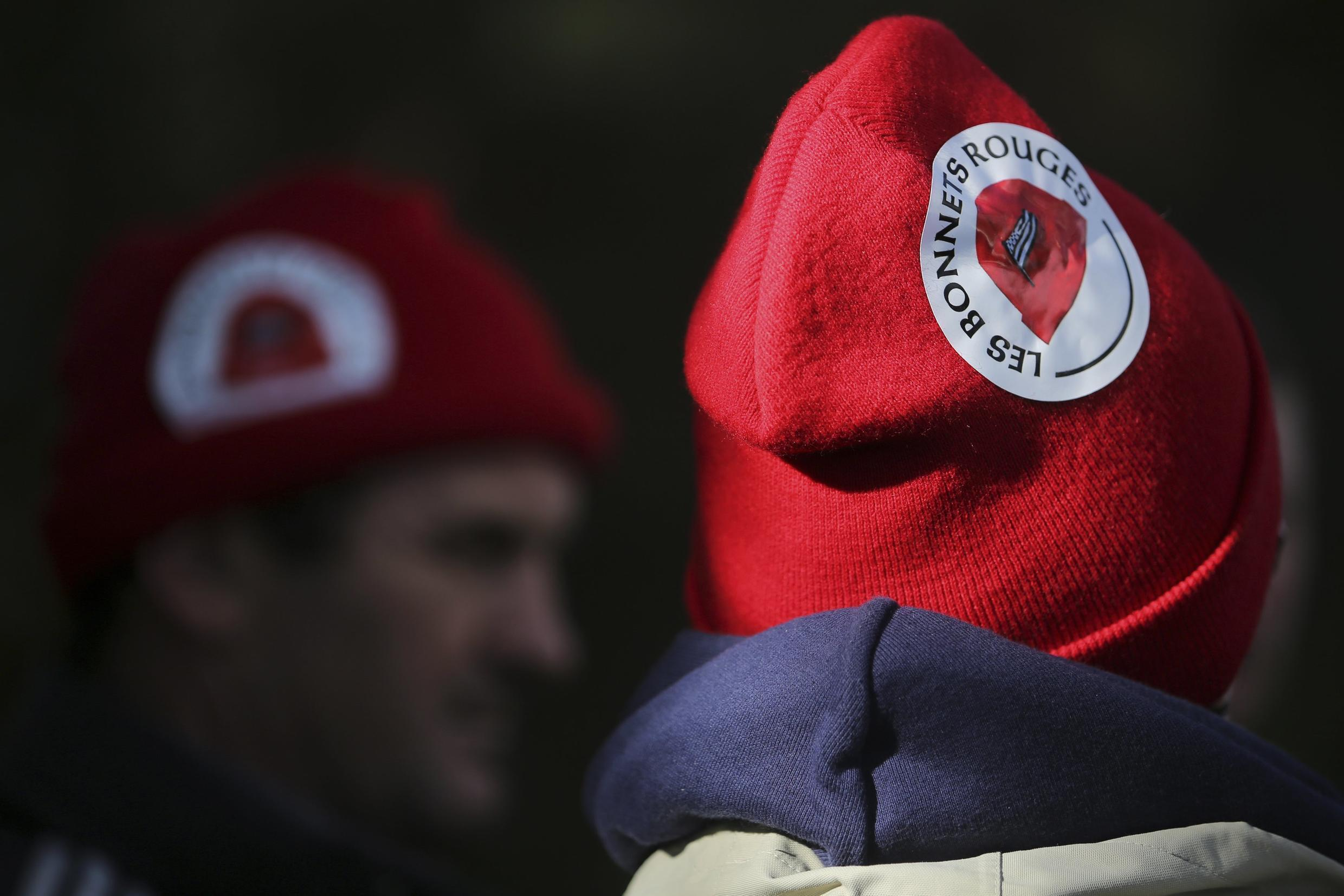 An employee of French firm Tilly-Sabco wears a red cap