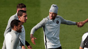 Paris Saint-Germain's Neymar, Angel Di Maria and teammates train before their match against Bayern Munich.