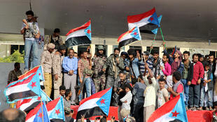 Supporters of southern Yemeni separatists take part in an anti-government protest in Aden