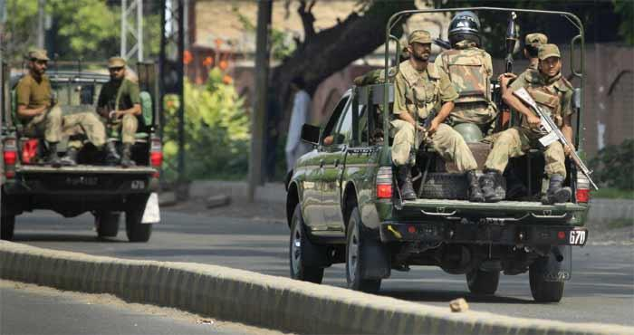 Pakistani army soldiers patrol near the US consulate in Peshawar