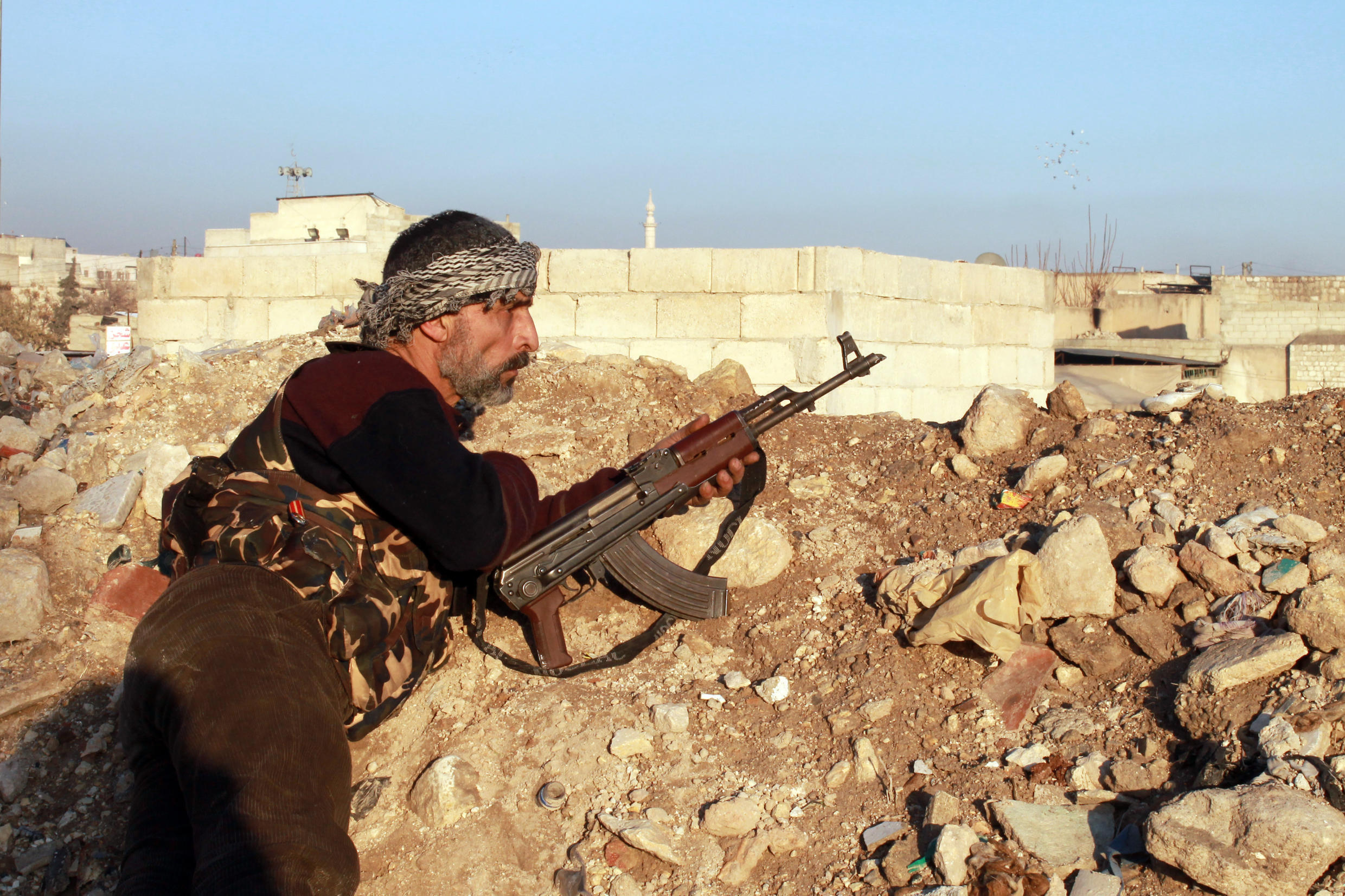 A rebel fighter in Aleppo during clashes with fighters from the jihadist group Islamic State in Iraq and the Levant on January 7.