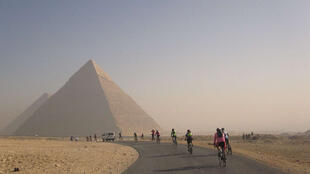 Tour d'Afrique cycling past the Egyptian pyramids