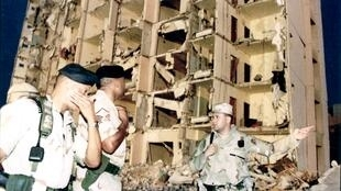 US military personnel survey damage to Khobar Towers in Dhahran, Saudi Arabia, where 19 US citizens were killed in June 1996