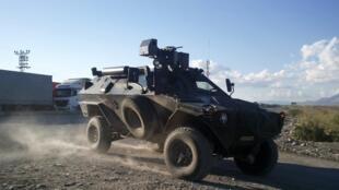 An armoured Turkish army vehicle escorts military trucks near the southeastern town of Silopi on the Turkish-Iraqi border